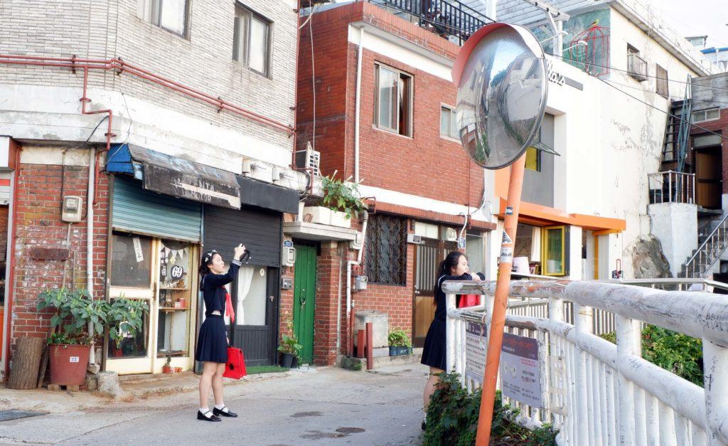 Korean students hang around taking photos at Ihwa Mural Village
