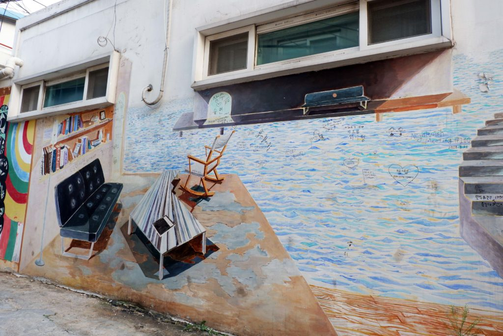 Creative murals on the walls at Ihwa Mural Village