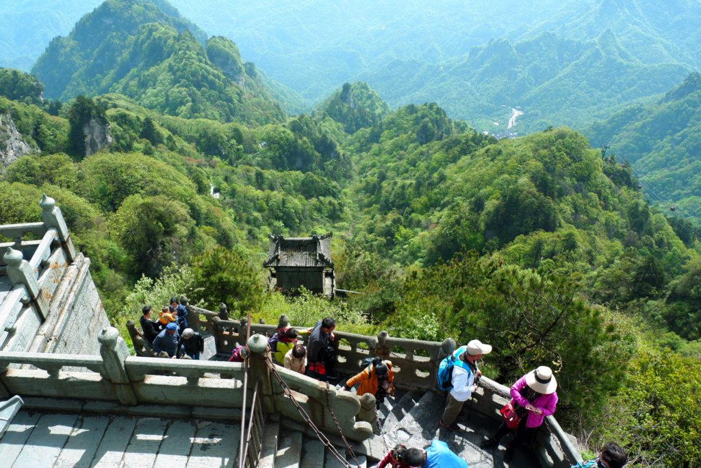 People trekking up to the Golden Palace from the cable car station