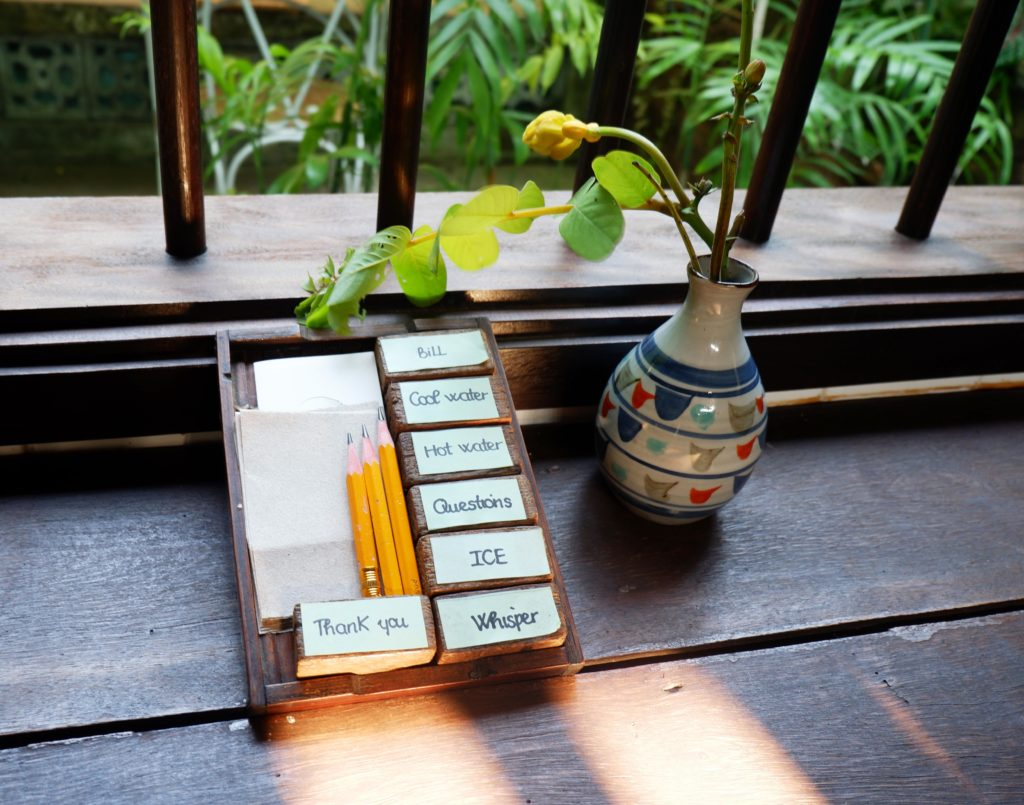 You communicate with the staff at Reaching Out Tea House by writing or by showing these cubes