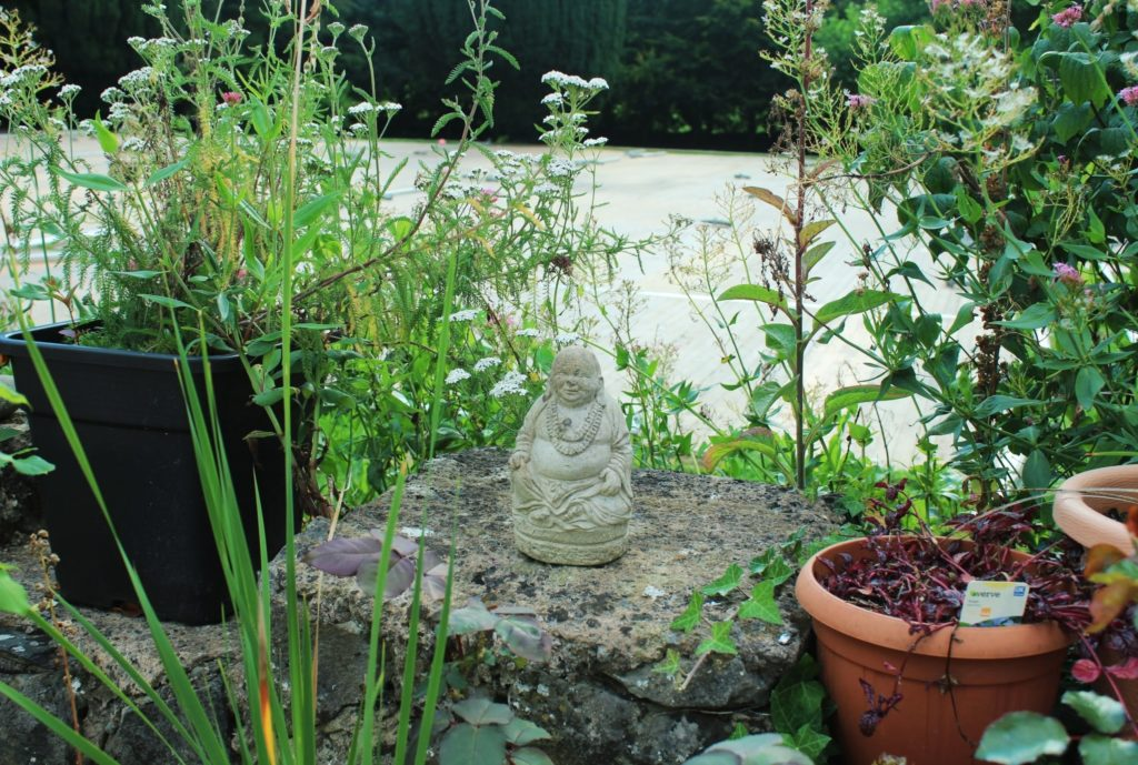 Buddha statue in the garden of Manjushri Kadampa Meditation Centre